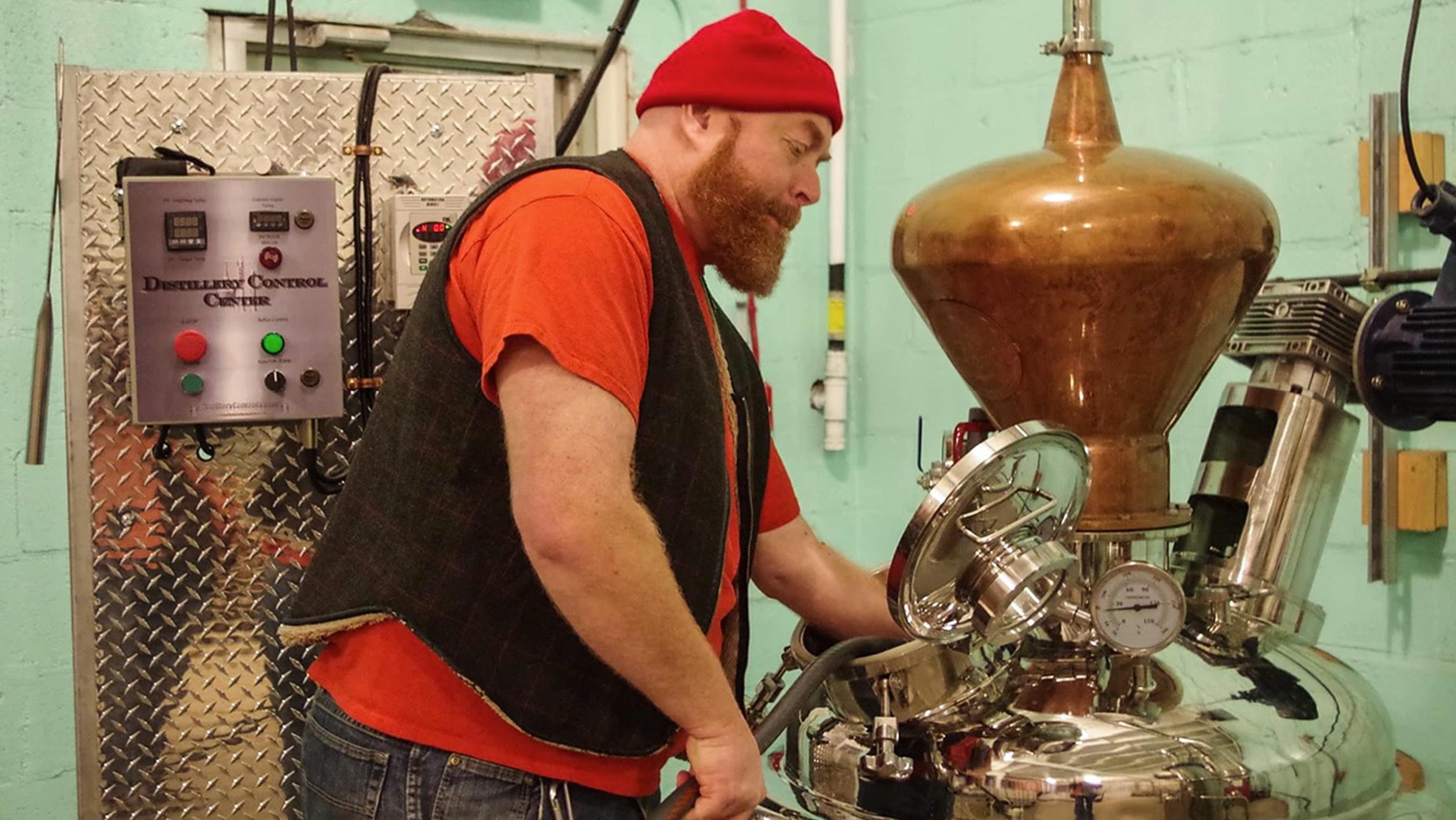 Master Distiller Dean Browne looking at stills