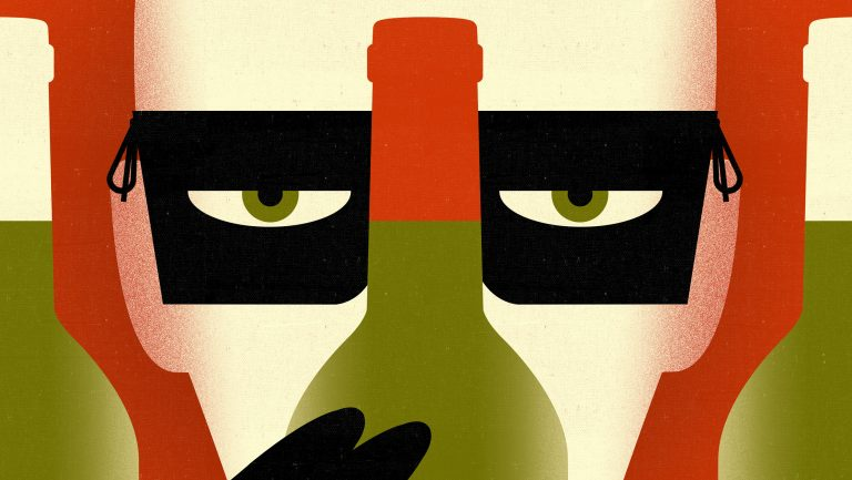 Masked man peering behind a bottle of wine