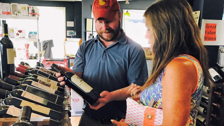 Down East Wine customer selecting wine