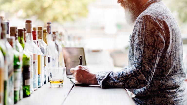 Man taking notes at a bar