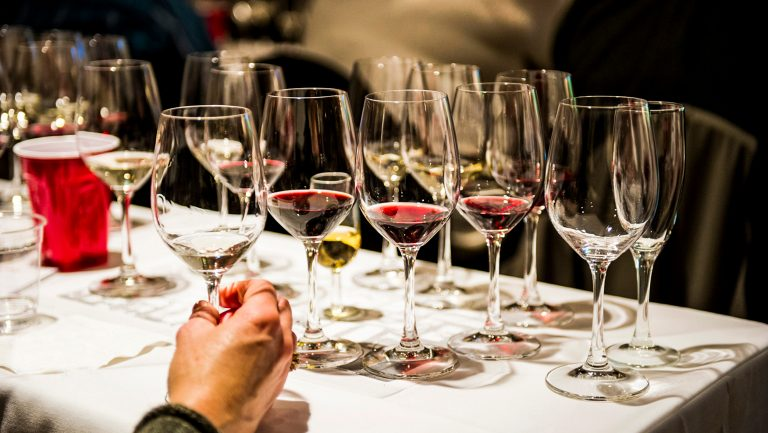 numerous glasses of wine on a table