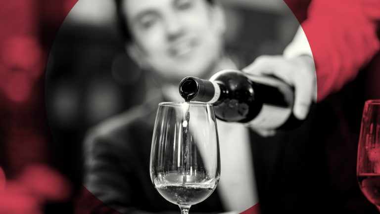 sommelier pouring wine